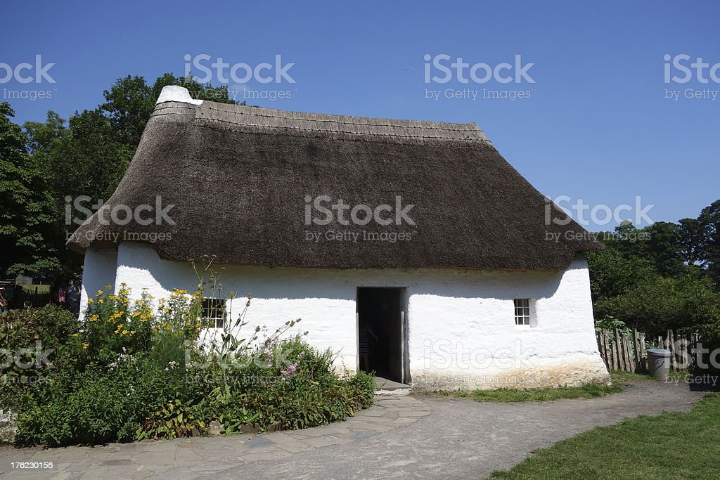 ancient stunning white-washed stone and thatched cottage stock photo