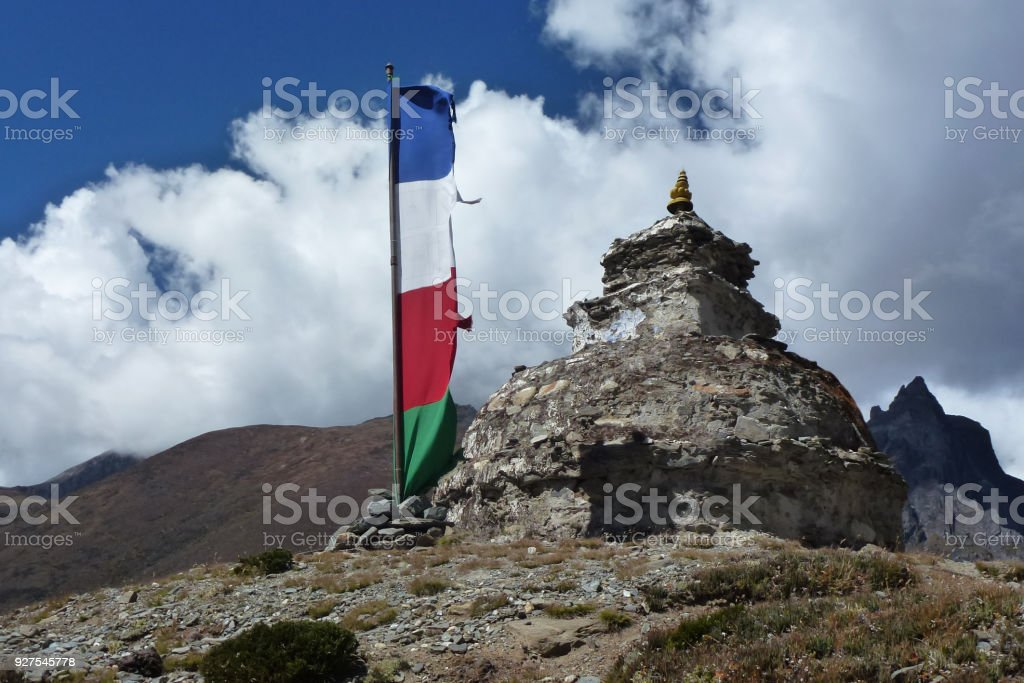 Ancient stupa in Dingboche, with prayer flags, Everest Base Camp trek, Nepal stock photo