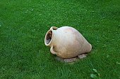 Ancient Style Armenian Wine Jar Isolated on Vibrant Green Lawn