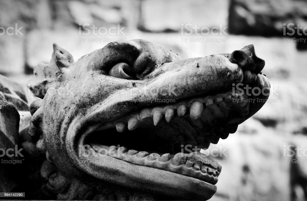 Ancient style sculpture of angry wolf in Florence, Italy. stock photo