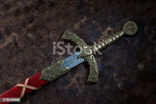 Ancient sword with the bronze hand holdon a beautiful background