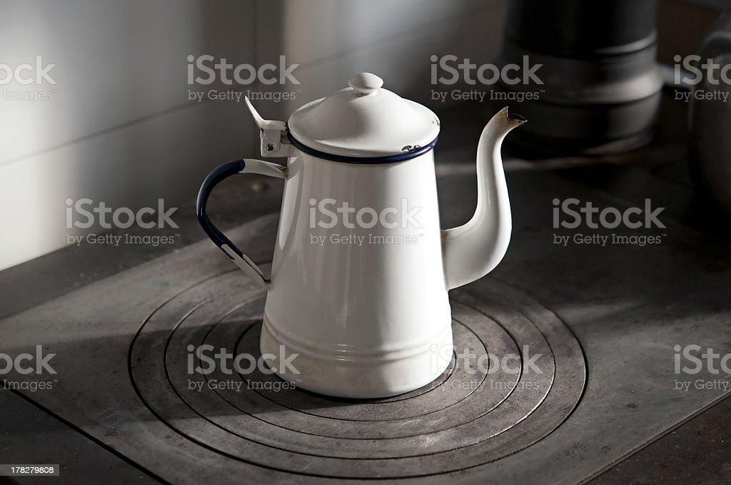 ancient teapot on the stove royalty-free stock photo