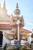ancient temple guardian in front of Temple of Dawn (Wat Arun Buddhist Temple) is white demon giant statue named Sahatsadecha. Thailand Traditional Tourist Attraction, Thai Travel and Tourism concept