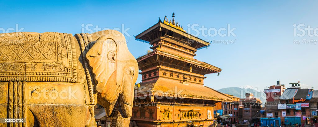 Ancient temples and elephant statues overlooking square Bhaktapur Kathmandu Nepal stock photo