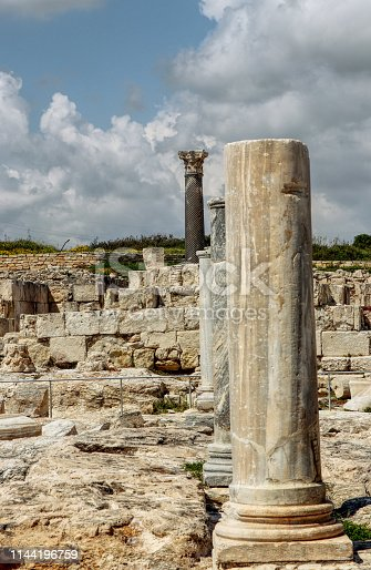 Ancient temples in main touristic attractions of Cyprus island - Kourion. Ruins of rome ancient. Old white and black marble columns. Ancient colums in line. Limassol district.