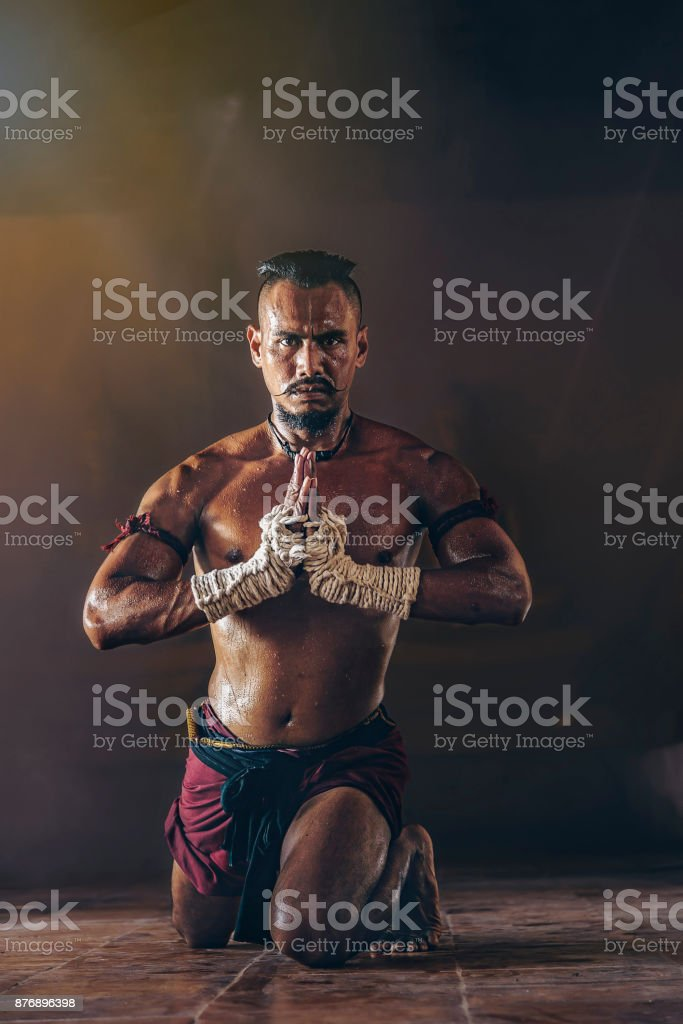 Ancient Thai boxers are practicing with intention. stock photo