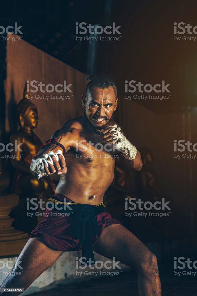 Ancient Thai boxers are practicing with intention.Thai temples are accessible to the public. In Ayutthaya Thailand stock photo