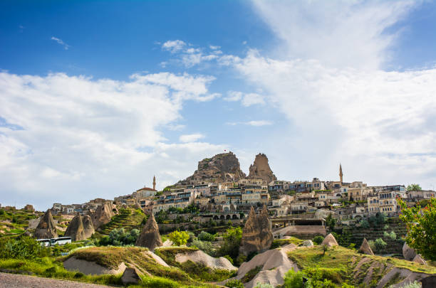 Ancient town and a castle of Uchisar, Cappadocia, Turkey Ancient town and a castle of Uchisar, Cappadocia, Turkey anatolia stock pictures, royalty-free photos & images