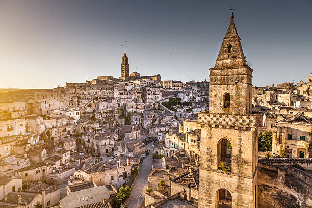 Ancient town of Matera at sunrise, Basilicata, Italy Ancient town of Matera (Sassi di Matera), European Capital of Culture 2019, in beautiful golden morning light, Basilicata, southern Italy. matera italy stock pictures, royalty-free photos & images