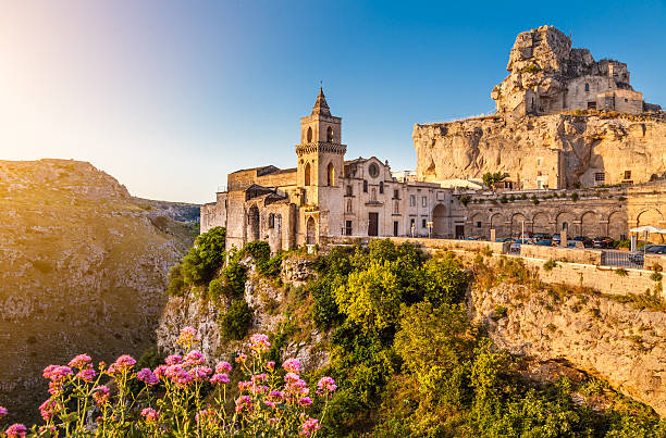 Ancient town of Matera at sunrise, Basilicata, Italy Ancient town of Matera (Sassi di Matera) at sunrise, Basilicata, southern Italy. matera italy stock pictures, royalty-free photos & images