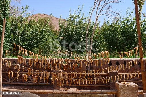 istock Ancient traditional residential old house in Tuyoq village valley inTurpan Xinjiang Province China. 1180462460