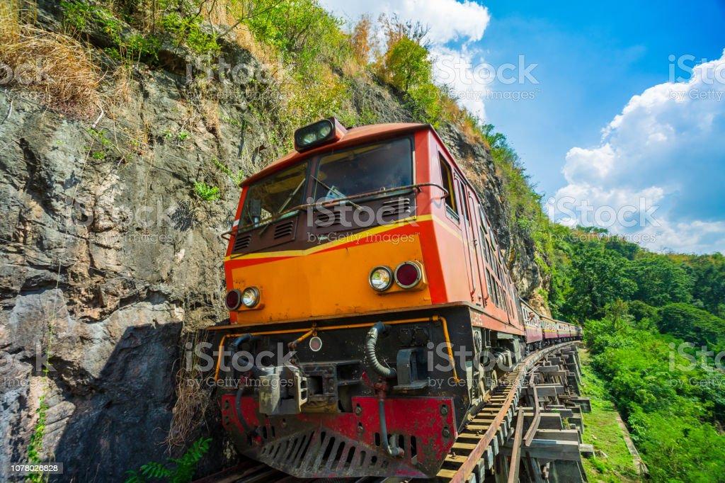 Ancient train running on wooden railway in Tham Krasae stock photo