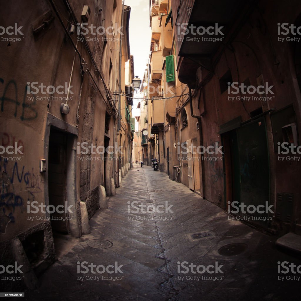 Ancient Tuscan narrow alley in Pisa - Italy royalty-free stock photo