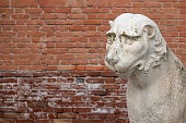 Ancient Venetian Piraeus lion head near Arsenal in Venice with copy space for text, Italy