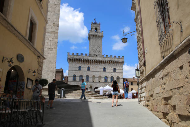 Ancient village Montepulciano of Tuscany. Landscape of the Tuscan countryside and views of Montepulciano. Montepulciano- Tuscany- iItaly- 16 June 2018: Views of the ancient village of Montepulciano in Tuscany. Piazza Grande, the ancient castle. piazza grande stock pictures, royalty-free photos & images
