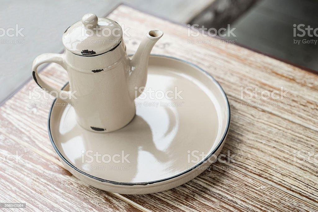 Ancient vintage metal teapot and bottom plate photo libre de droits
