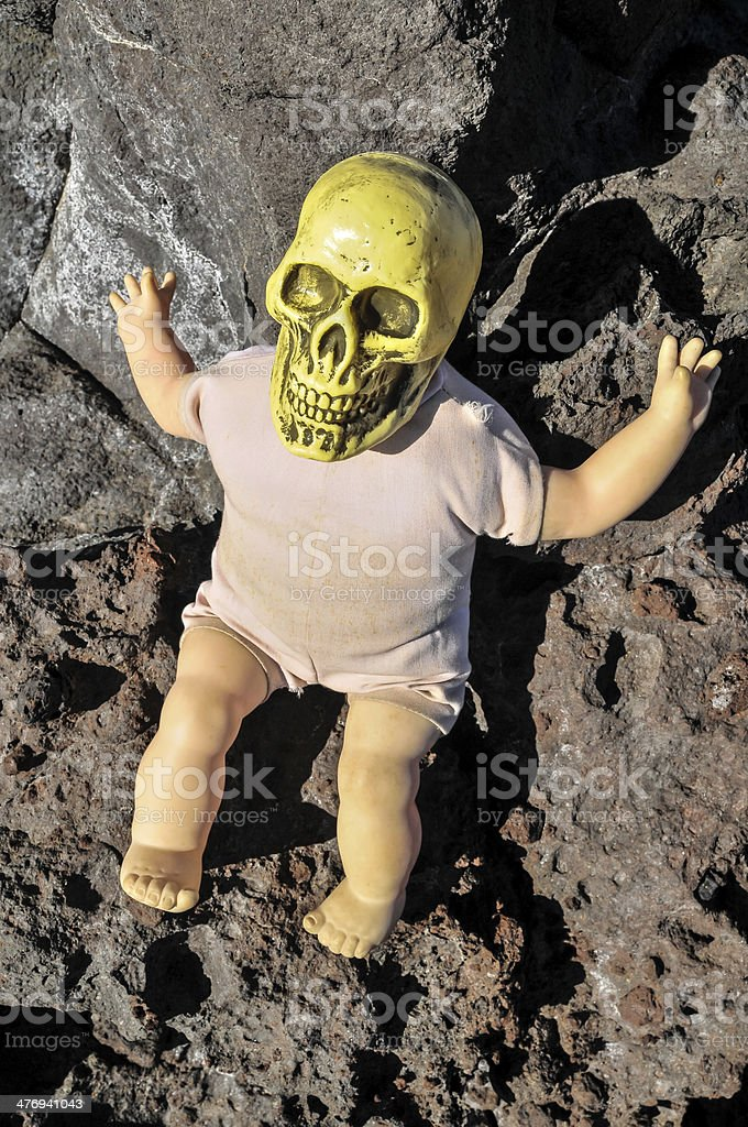 Ancient Vintage Old Doll with Human Skull stock photo