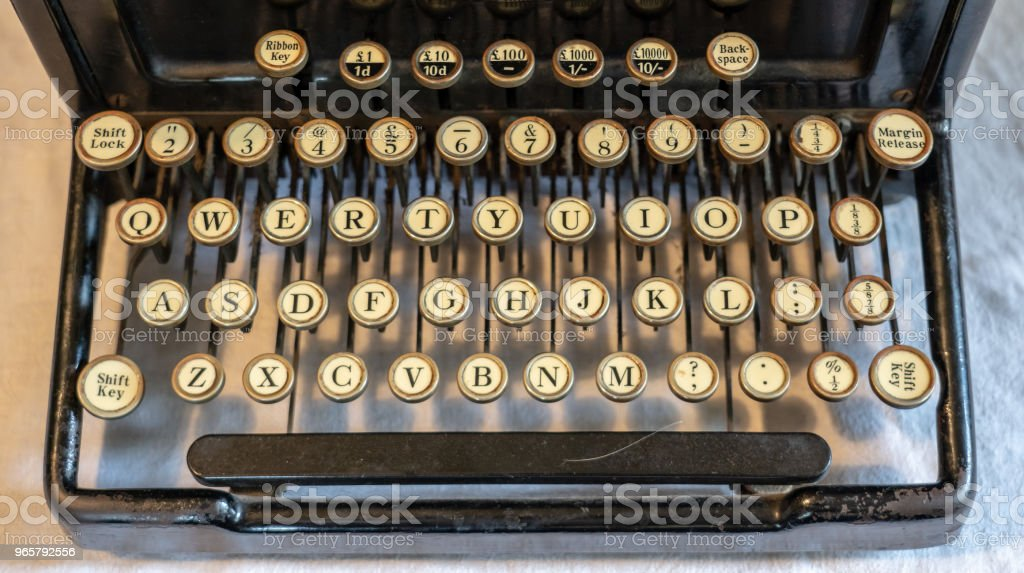 Ancient vintage portable typewriter with qwerty keyboard - Royalty-free Above Stock Photo