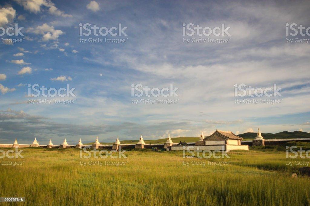 Ancient wall of Karakorum and field in Mongolia stock photo