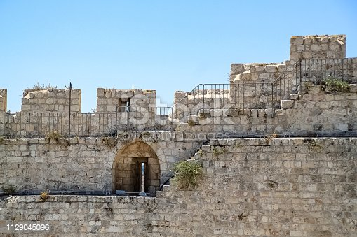 Ancient wall with arrowslit in the Old City of Jerusalem, Israel