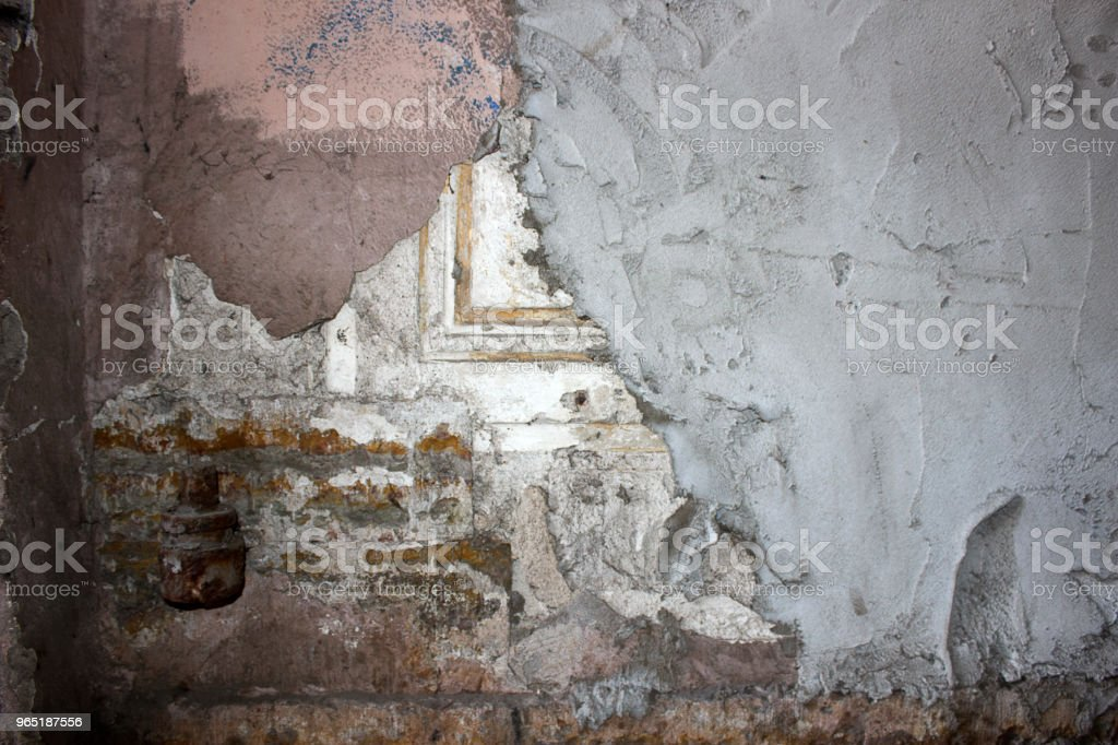 Ancient wall with ornament, plastered with concrete zbiór zdjęć royalty-free
