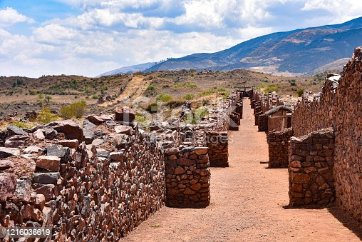 The stone walls of Pikillaqta, a large Wari culture archaeological site 20 kilometres south east of Cusco in the Quispicanchi Province. Cusco, Peru.