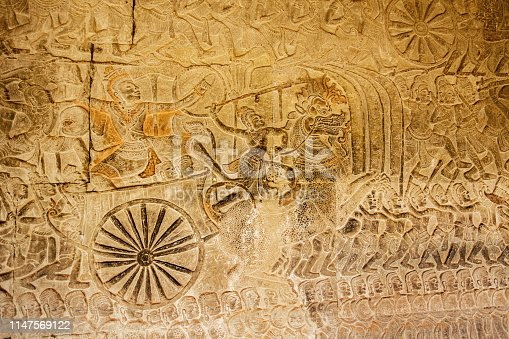 1147569123 istock photo Ancient war celebration with dragon parade on Relief in Angkor Wat, Cambodia 1147569122