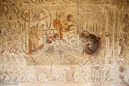 1147569123 istock photo Ancient War with elephant parade on Relief in Angkor Wat, Cambodia 1147569123
