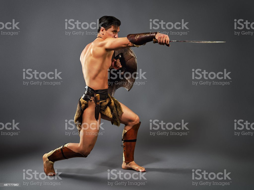 Ancient warrior. Blow with a sword stock photo
