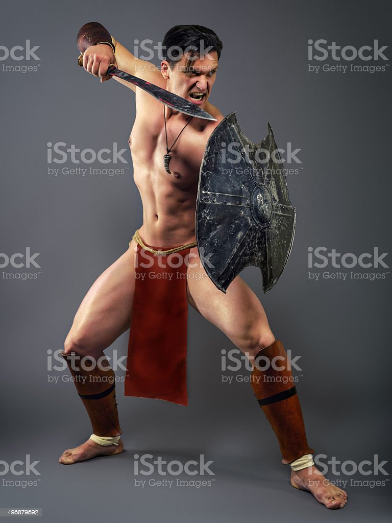 Ancient warrior in a combat stance stock photo