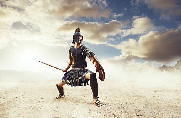 ancient warrior in a typical black costume holding a spear - roman stock photos and pictures