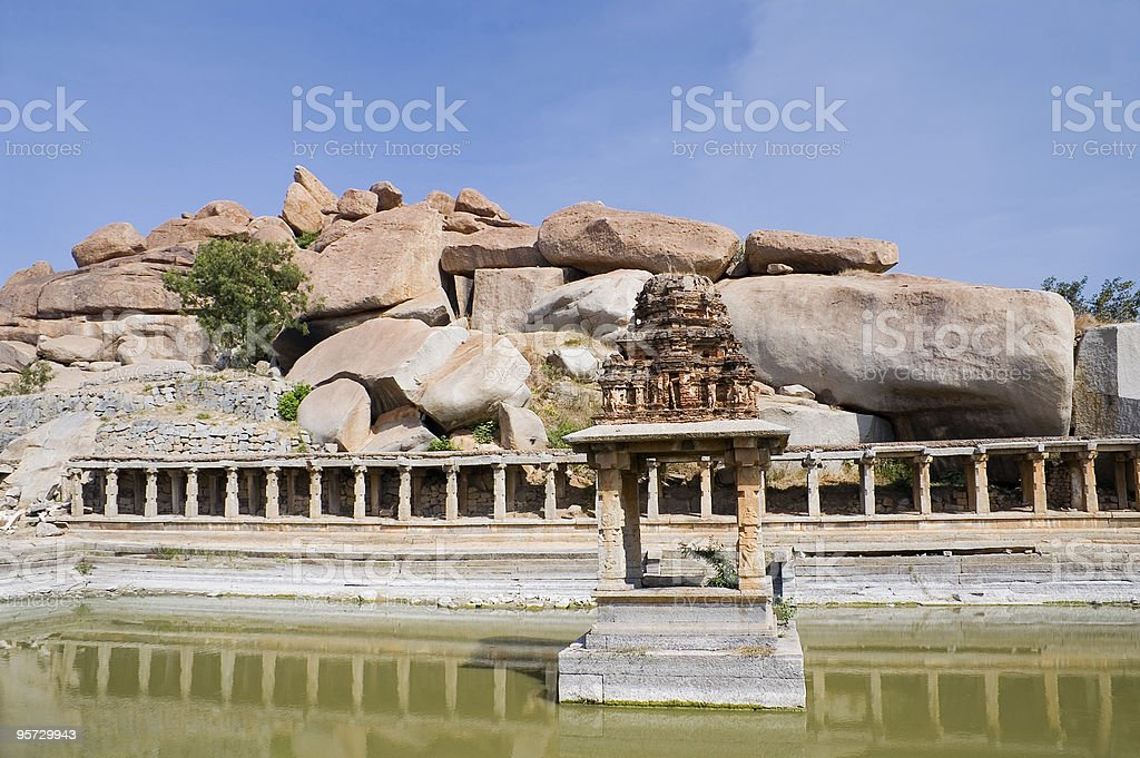 Ancient water pool and temple at Krishna market royalty-free stock photo