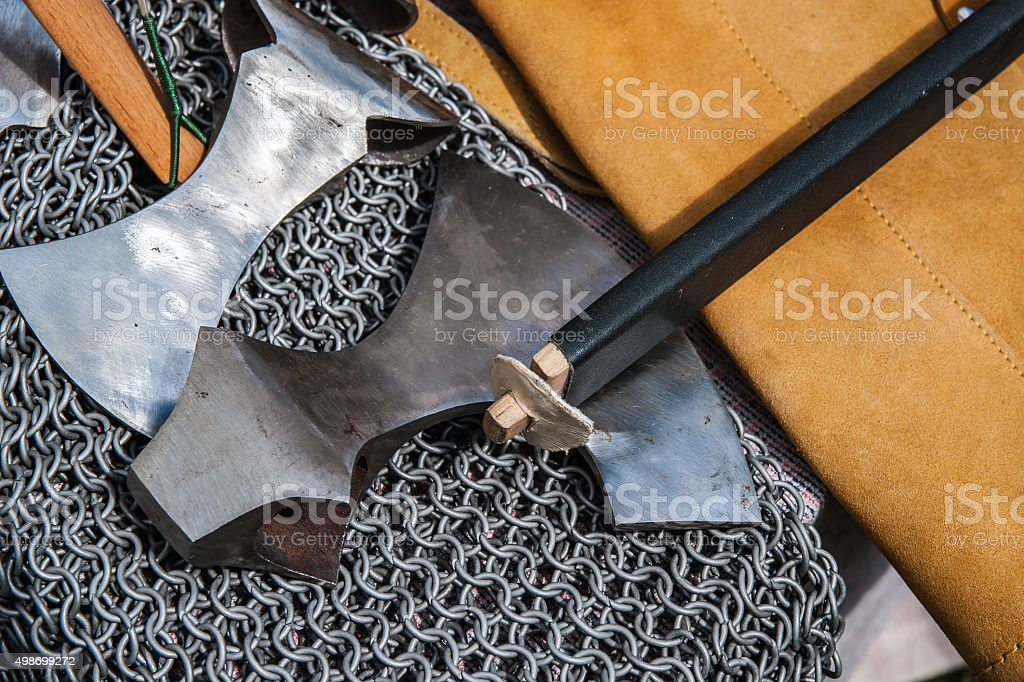 Ancient weapons and chain armor stock photo