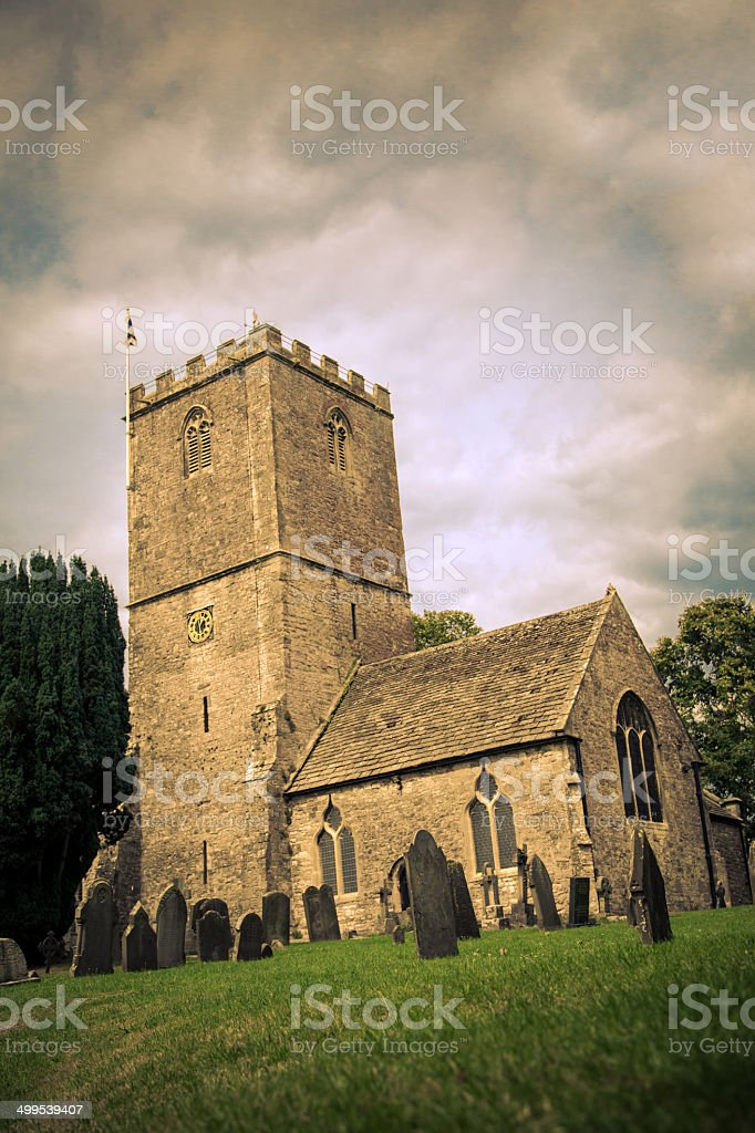 Ancient Welsh church with graveyard stock photo