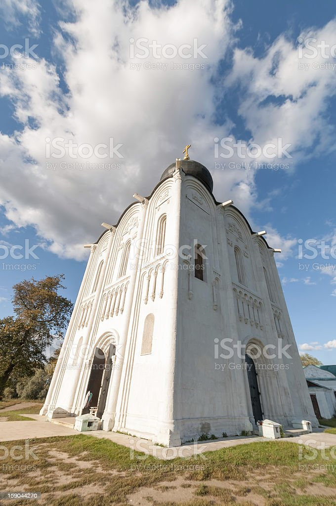 Ancient white-stone church against blue sky background royalty-free stock photo
