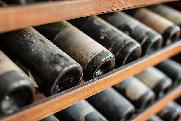 Ancient wine ancient wine bottles dusting in an underground cellar cellar stock pictures, royalty-free photos & images