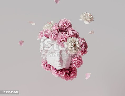 istock 3D Ancient woman Statue, white broken stone. Greek,roman  goodness style. Head sculpture pink flowers bouquet on gray background. Nature, Peonies, falling petals. Feminine beauty  abstract 3D render. 1293643267