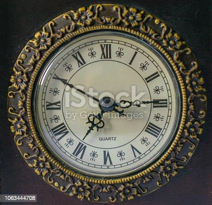 671883446 istock photo Ancient wooden  clock close up 1063444708