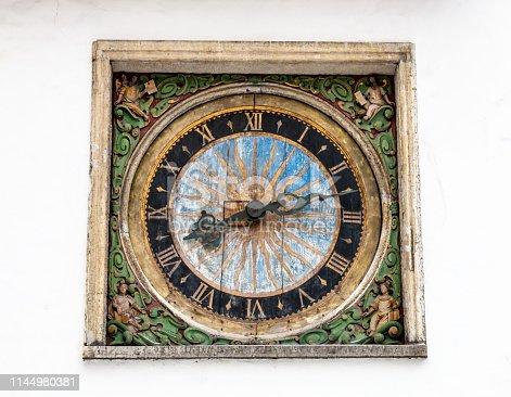 Old wooden clock in Tallinn, Estonia