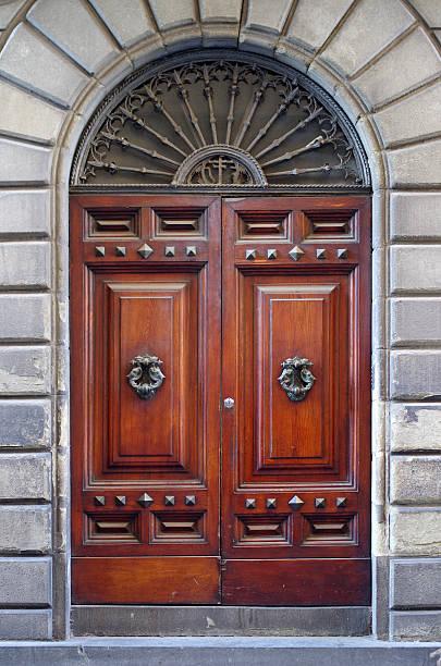 ancient wooden door of historic building stock photo