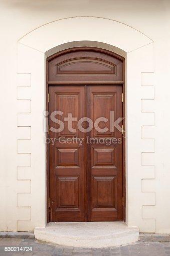 istock Ancient wooden door of historic building 830214724