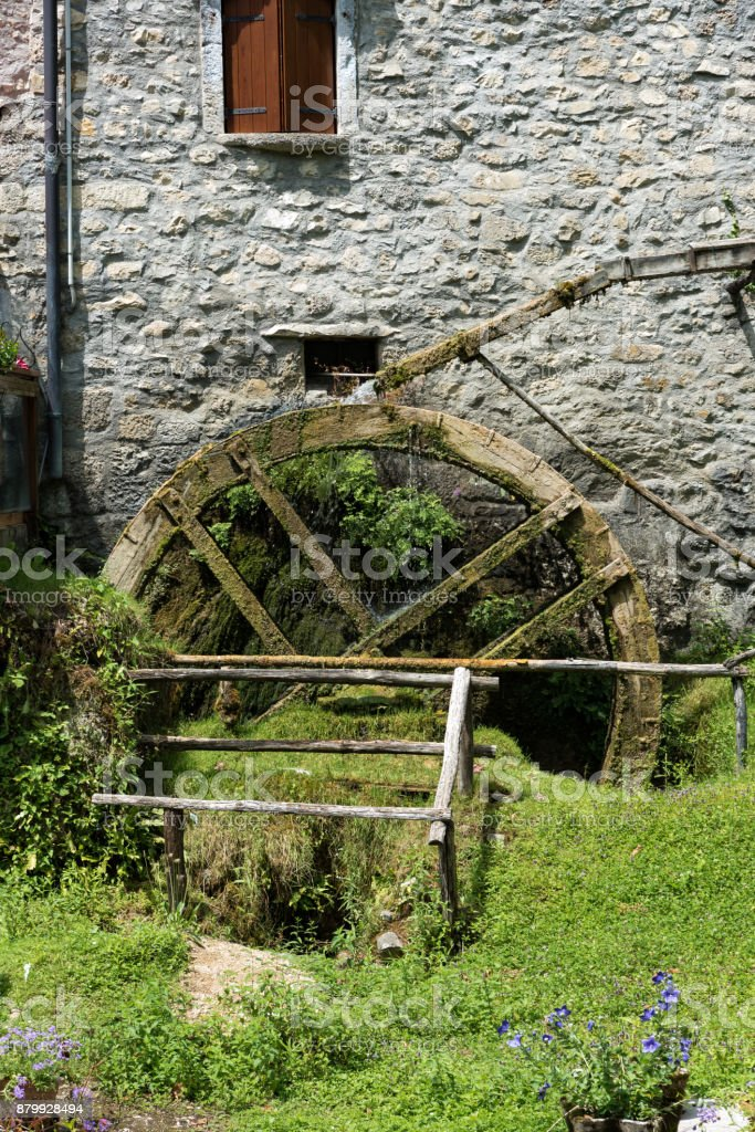 Ancient working water mill stock photo