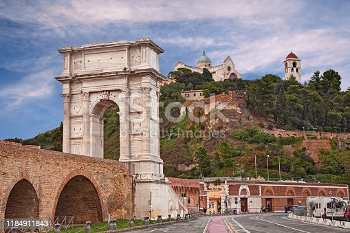 Ancona, Marche, Italy: the ancient Roman triumphal arch of Trajan built in the 2nd century AD in the port of the city and on background the medieval catherdral