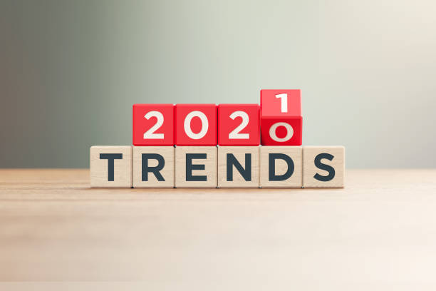 """""""2020"""" and """"2021 Trends"""" Written Red Wood Blocks Sitting on Wood Surface in Front a Defocused Background """"2020"""" and """"2021"""" Trends written red wood blocks sitting on a wood surface in front of a defocused background. Horizontal composition with copy space. fashionable stock pictures, royalty-free photos & images"""
