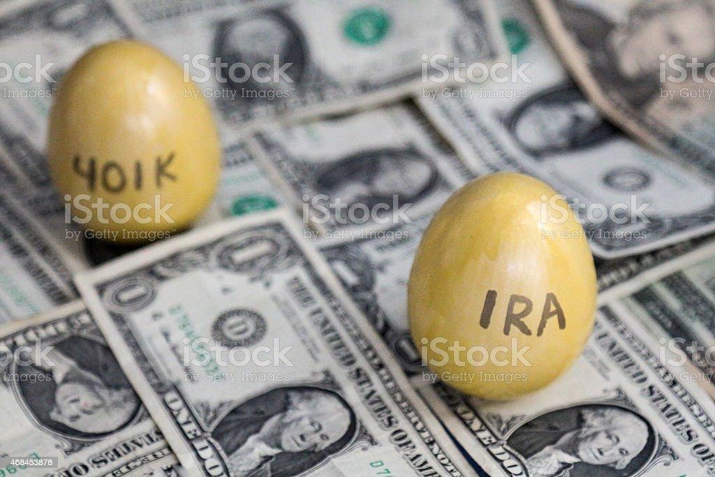 IRA and 401K golden eggs on one dollar bills stock photo
