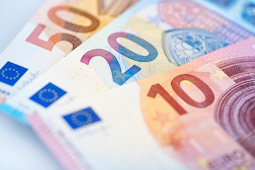High resolution photograph of three Euro banknotes.