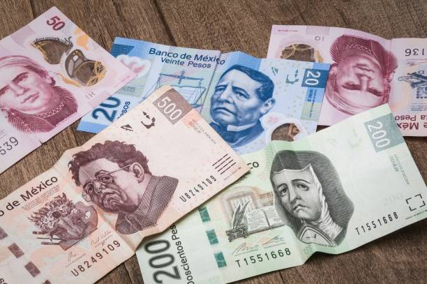 20, 50, 200 and 500 mexican pesos bills. Some bills of 20, 50, 200 and 500 mexican pesos appear to be sad. depreciation stock pictures, royalty-free photos & images