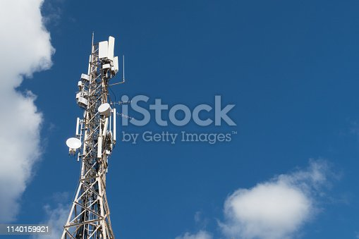 istock 4G and 5G cell site. Base Station or Base Transceiver Station. Telecommunication tower with antennas against blue sky. 1140159921