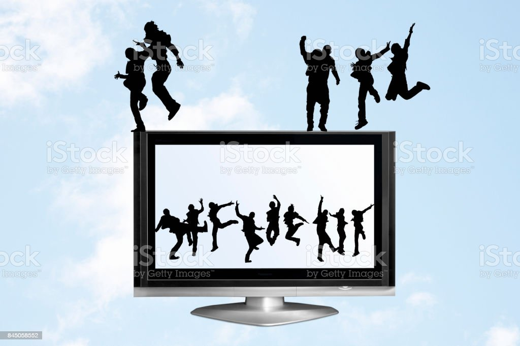 LCD TV and a human silhouette stock photo