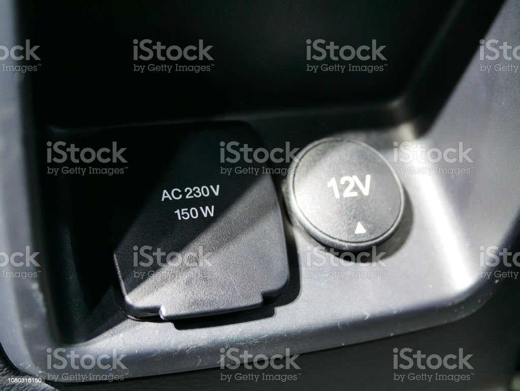DC 12 V and AC 230 V socket in the car stock photo